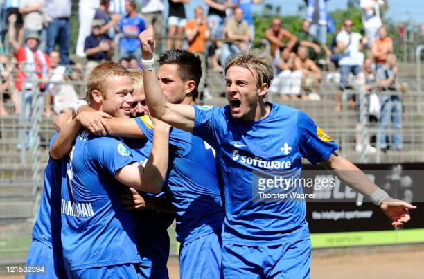 Players of Darmstadt celebrate after Kevin Woelk is scoring the opening goal during the Theard League match between SV Darmstadt 98 and SSV Jahn...