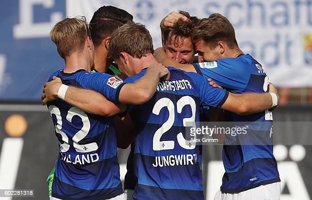 Players of Darmstadt celebrate after the Bundesliga match between SV Darmstadt 98 and Eintracht Frankfurt at JonathanHeimesStadion am Boellenfalltor...