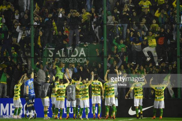 Players of Defensa y Justicia celebrate after winning a match between Banfield and Defensa y Justicia as part of Copa CONMEBOL Sudameriacana 2018 at...
