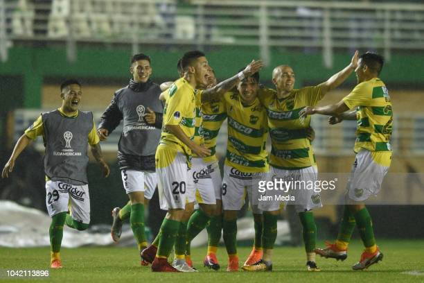 Players of Defensa y Justicia celebrate their team's second goal during a match between Banfield and Defensa y Justicia as part of Copa CONMEBOL...