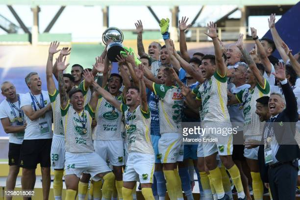 Players of Defensa y Justicia celebrate with the champions trophy after the final of Copa CONMEBOL Sudamericana 2020 between Lanús and Defensa y...