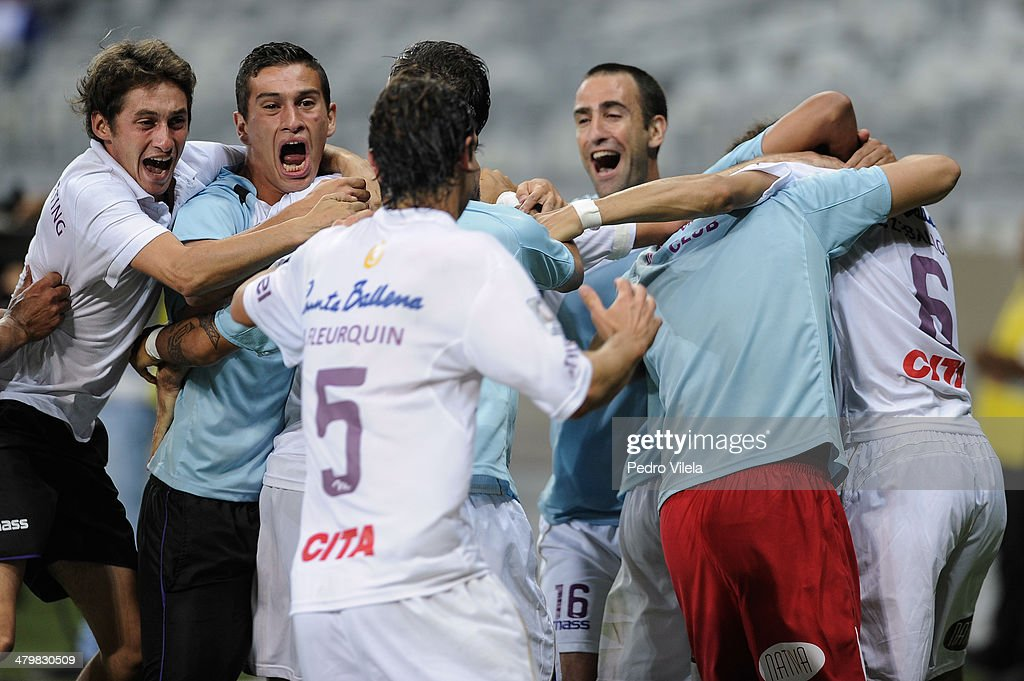 Players of Defensor celebrates during the match between Cruzeiro v Defensor for the Copa Briedgestone Libertadores 2014 at Mineirao stadium on march 20, 2014 in Belo Horizonte, Brazil.