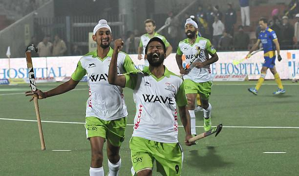 Players of Delhi Waveriders celebrating after scoring a goal against Jaypee Punjab Warriors during the Coal Hockey India League match at Hockey...
