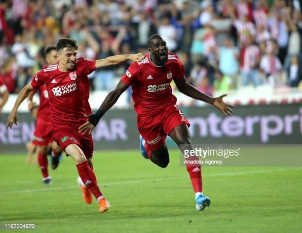 Players of Demir Grup Sivasspor celebrate after scoring a goal during the Turkish Super Lig soccer match between Demir Grup Sivasspor and Besiktas at...