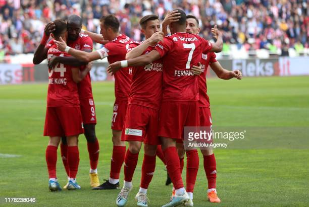 Players of Demir Grup Sivasspor celebrate after scoring a goal during the Turkish Super Lig match between Demir Grup Sivasspor and Antalyaspor at the...