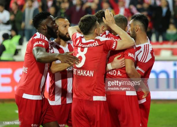 Players of Demir Grup Sivasspor celebrate after scoring a goal during the Turkish Super Lig football match between Demir Grup Sivasspor and...