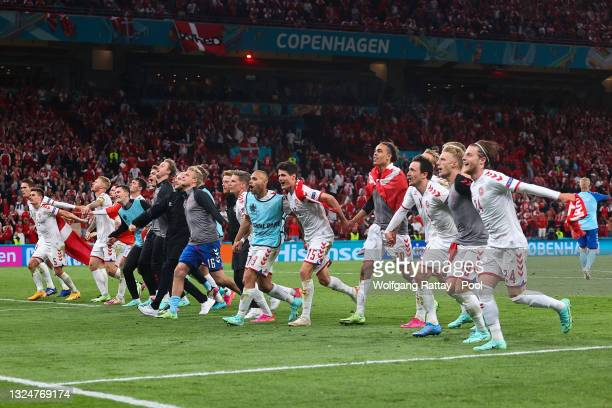 Players of Denmark celebrate in front of their fans following their side's victory in the UEFA Euro 2020 Championship Group B match between Russia...