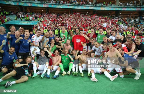 Players of Denmark celebrate their side's victory in front of the fans after the UEFA Euro 2020 Championship Quarter-final match between Czech...