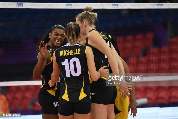 Players of Dentil Paraia Clube celebrate victory during 2018 FIVB Women's Club World Championship Supreme v Praia at Olympic Sports Center on...