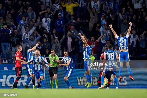 Players of Deportivo de La Coruna celebrate their team second goal scored by Quique Gonzalez during the La Liga 123 play off match between Deportivo...
