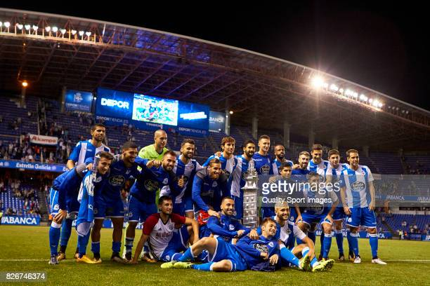 Players of Deportivo de La Coruna pose with the trophy after the Pre Season Friendly match between Deportivo de La Corua and West Bromwich Albion at...