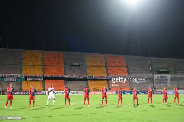Players of Deportivo Independiente Medellin line up during the ceremony prior a group H match of Copa CONMEBOL Libertadores 2020 between...