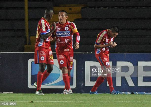 Players of Deportivo Pasto celebrate a goal during a match between Millonarios and Pasto as part of Liga Postobon 2014 II at Nemesio Camacho El...