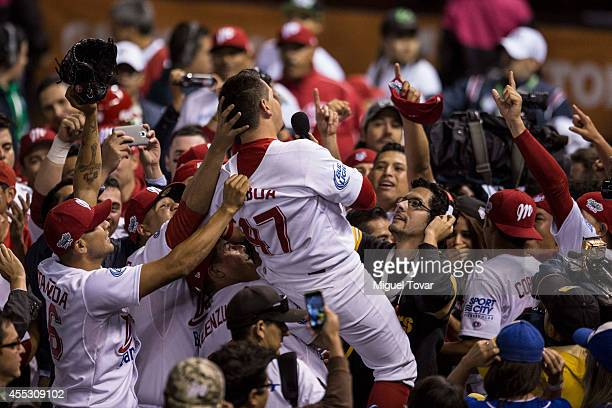 Players of Diablos celebrate after their teammate Juan Gamboa made a home run to winning the final match between Pericos de Puebla and Diablos Rojos...