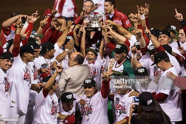 Players of Diablos celebrate after winning the championship after a match between Pericos de Puebla and Diablos Rojos as part of Serie del Rey...