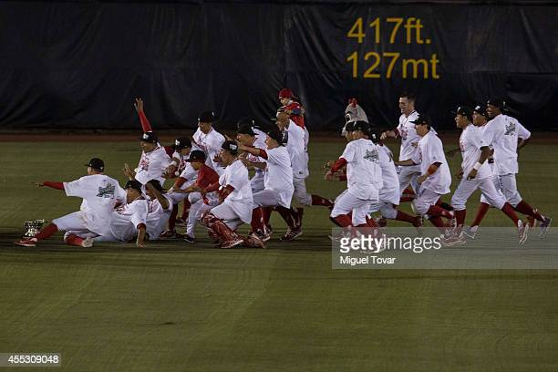 Players of Diablos celebrate after winning the during a match between Pericos de Puebla and Diablos Rojos as part of Serie del Rey Mexican Baseball...