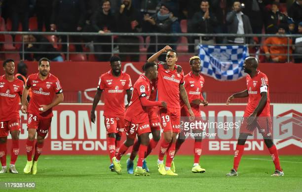 Players of Dijon celebrate during the Ligue 1 match between Dijon and Paris Saint Germain on November 1 2019 in Dijon France