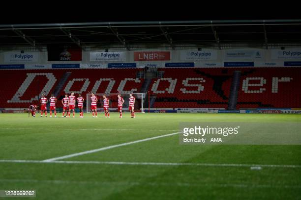 Players of Doncaster Rovers takes wait to take their penalties during the EFL Trophy match between Doncaster Rovers v Bradford City at Keepmoat...