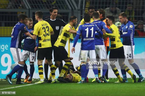 Players of Dortmund and Schalke argue during the Bundesliga match between Borussia Dortmund and FC Schalke 04 at Signal Iduna Park on November 25...