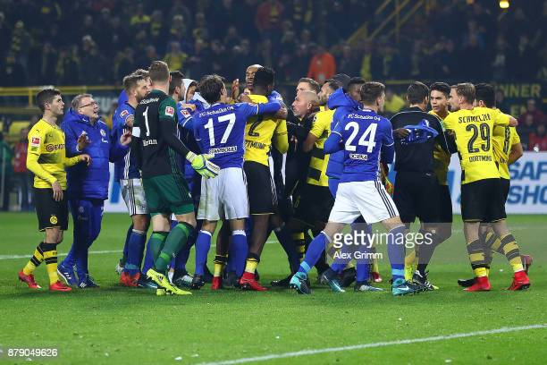 Players of Dortmund and Schalke fight after the Bundesliga match between Borussia Dortmund and FC Schalke 04 at Signal Iduna Park on November 25 2017...