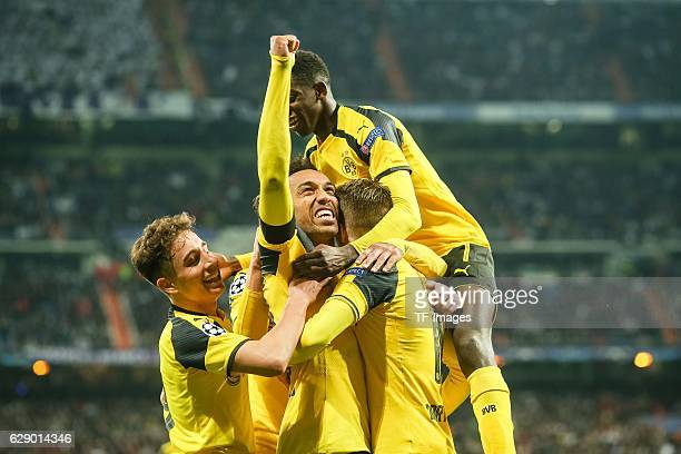 Players of Dortmund celebrate a goal during the UEFA Champions League match between Real Madrid CF and Borussia Dortmund at Bernabeu on December 7...