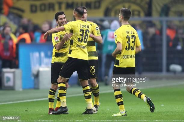 Players of Dortmund celebrate after Benjamin Stambouli of Schalke scored an owe goal to make it 20 during the Bundesliga match between Borussia...