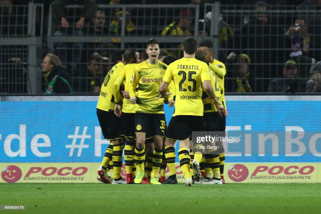Players of Dortmund celebrate after Christian Pulisic of Dortmund (covered) scored a goal to make it 2:1 during the Bundesliga match between Borussia Dortmund and TSG 1899 Hoffenheim at Signal Iduna Park on December 16, 2017 in Dortmund, Germany.
