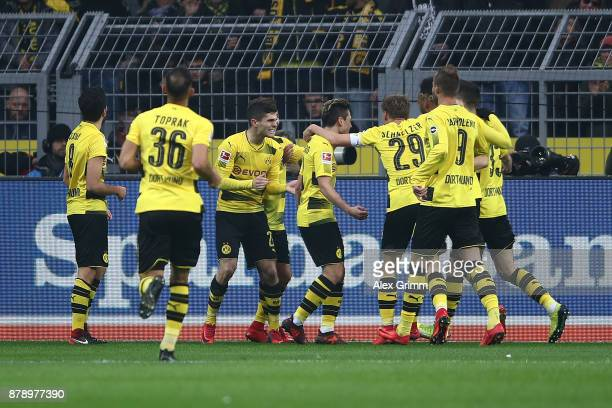 Players of Dortmund celebrate after Mario Goetze of Dortmund scored a goal to m make it 30 during the Bundesliga match between Borussia Dortmund and...