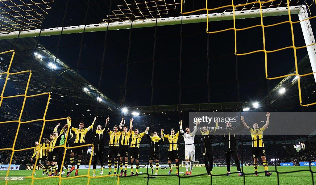 Players of Dortmund celebrate at the end of the Bundesliga match between Borussia Dortmund and Bayern Muenchen at Signal Iduna Park on November 19, 2016 in Dortmund, Germany.