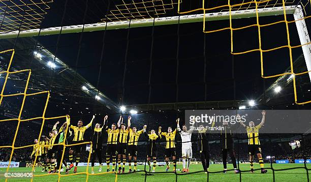 Players of Dortmund celebrate at the end of the Bundesliga match between Borussia Dortmund and Bayern Muenchen at Signal Iduna Park on November 19...