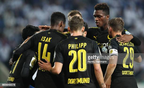 Players of Dortmund celebrate their team's opening goal during the DFB Cup match between 1 FC Magdeburg and Borussia Dortmund at MDCCArena on October...
