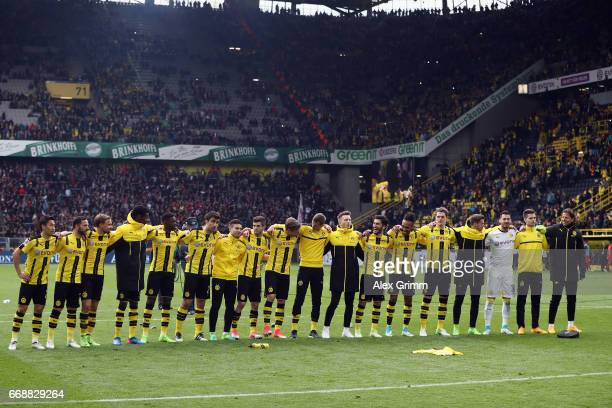 Players of Dortmund celebrate with the fans after the Bundesliga match between Borussia Dortmund and Eintracht Frankfurt at Signal Iduna Park on...