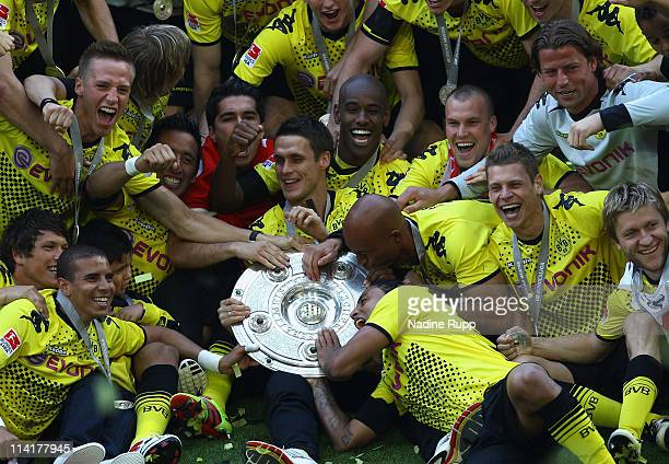 Players of Dortmund celebrate with the trophy winning the German Championship after the Bundesliga match between Borussia Dortmund and Eintracht...