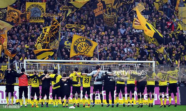 Players of Dortmund celebrates with their fans after winning the Bundesliga match between Borussia Dortmund and SV Werder Bremen at Signal Iduna Park...