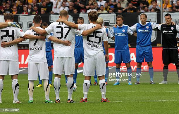 Players of Dresden and Rostock are pictured prior to the Second Bundesliga match between SG Dynamo Dresden and FC Hansa Rostock at Gluecksgas-Stadion...