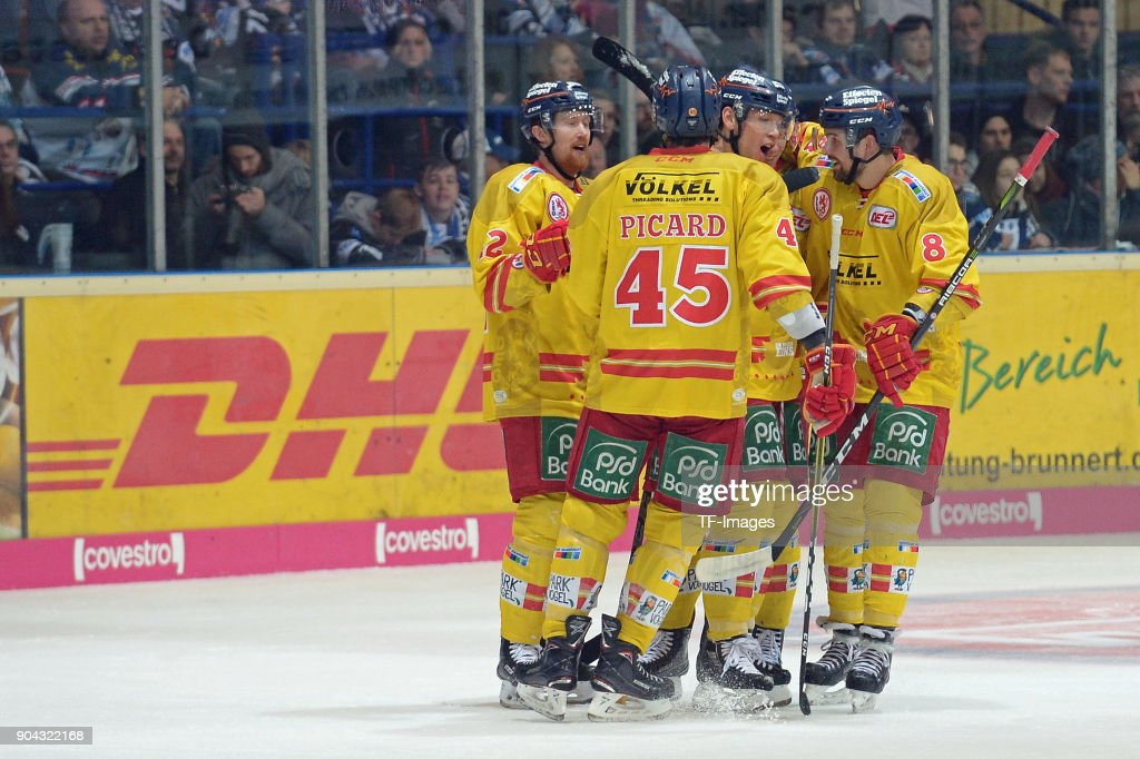 Players of Duesseldorf celebrate their team`s third goal during the DEL match between Iserlohn Roosters and Duesseldorfer EG at Eissporthalle Iserlohn on January 12, 2018 in Iserlohn, Germany.