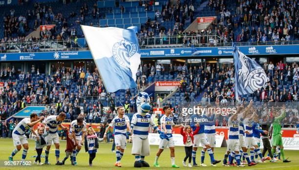 Players of Duisburg celebrate after winning the Second Bundesliga match between MSV Duisburg and SSV Jahn Regensburg at Schauinsland-Reisen-Arena on...