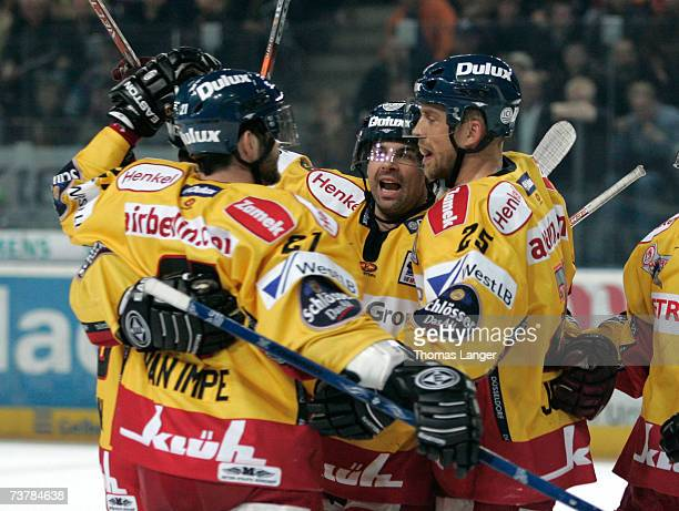 Players of Dusseldorf celebrate after Craig Johnson's first goal during the DEL Play Off semi final match between Sinupret Ice Tigers and DEG Metro...
