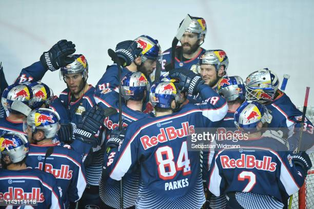 Players of EHC Muenchen celebrate after the seventh game of the DEL PlayOffs Semi Final between EHC Red Bull Muenchen and Augsburger Panther at...