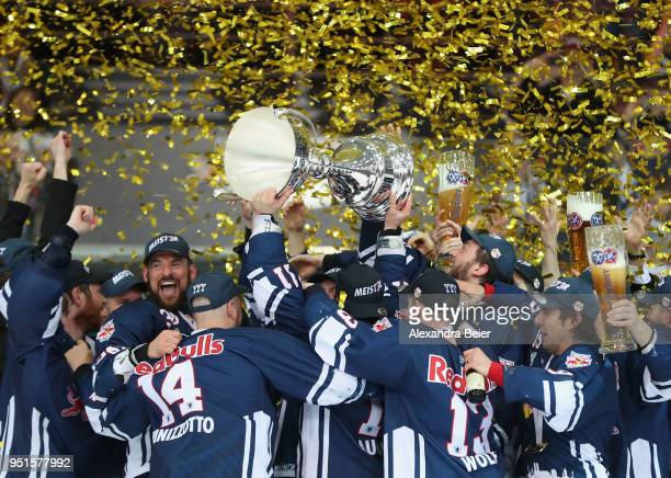 Players of EHC Red Bull Muenchen celebrate their German Championship title after the DEL Playoffs Final Match 7 between EHC Red Bull Muenchen and...