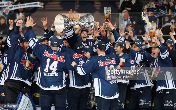 Players of EHC Red Bull Muenchen celebrate their German Championship title after the DEL Play-offs Final Match 7 between EHC Red Bull Muenchen and...