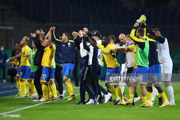 Players of Eintracht Braunschweig celebrate with fans following their victory in the DFB Cup first round match between Eintracht Braunschweig and...