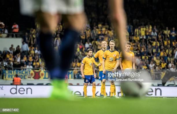Players of Eintracht Braunschweig wait for a freekick during the Bundesliga Playoff Leg 2 match between Eintracht Braunschweig and VfL Wolfsburg at...