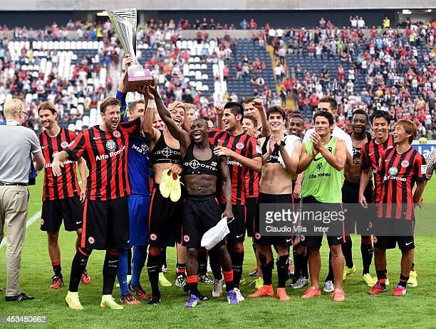 Players of Eintracht Frankfurt celebrate with the trophy after winning the pre-season friendly match between Eintracht Frankfurt and FC...