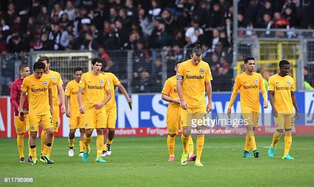 Players of Eintracht Frankfurt leave dejected after the Bundesliga match between Sport Club Freiburg and Eintracht Frankfurt at SchwarzwaldStadion on...
