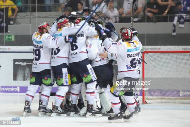 Players of Eisbaeren Berlin celebrate victory after winning the DEL Playoff final match 5 between EHC Red Bull Muenchen and Eisbaeren Berlin at...