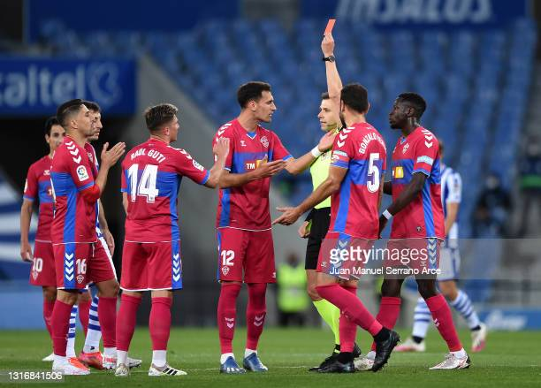 Players of Elche CF react after Raul Guti is shown a red card by referee Adrian Cordero Vega during the La Liga Santander match between Real Sociedad...