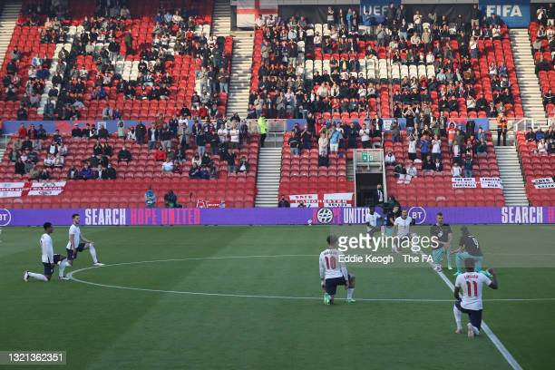 Players of England and Austria take the knee ahead of the international friendly match between England and Austria at Riverside Stadium on June 02,...
