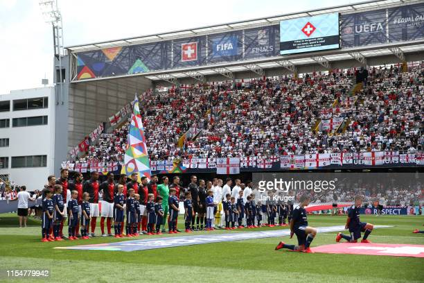 Players of England and Switzerland line up ahead of the UEFA Nations League Third Place Playoff match between Switzerland and England at Estadio D...
