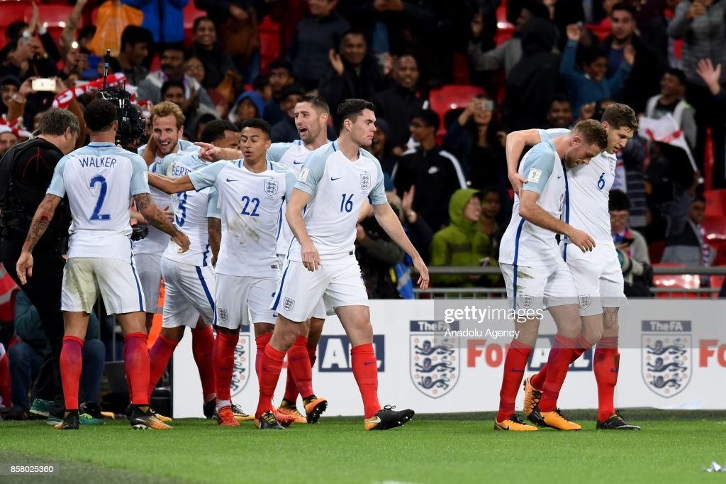 Players of England celebrate after scoring a goal during the 2018 FIFA World Cup European Qualification football match between England and Slovenia at Wembley Stadium in London, United Kingdom on October 05, 2017.